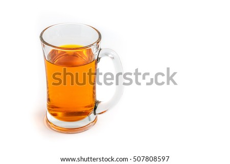 A glass of orange color water on white background isolated with copy space