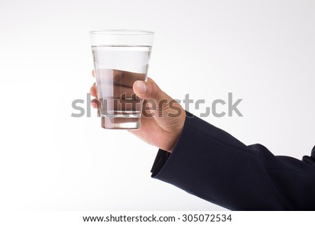 A glass of pure water in hand. businessman