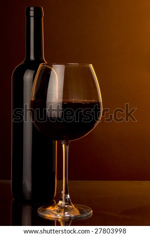 a glass of red wine and bottle