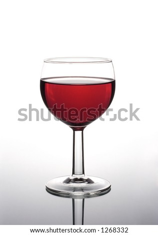 A glass of red wine isolated on a white background, with reflection