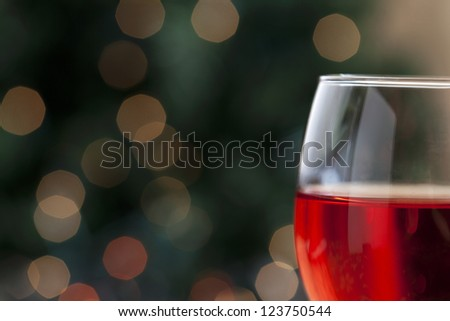 A glass of red wine on a holiday season - stock photo