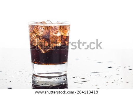 A glass of refreshing cold fizzy cola drinks