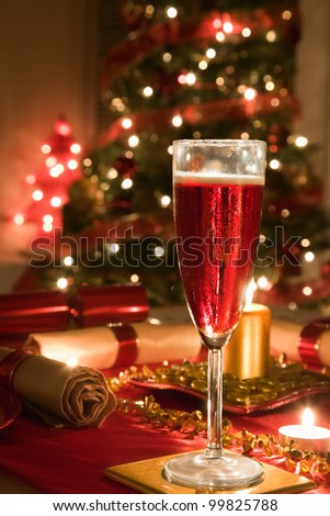 A Glass of Rose Champagne on a decorated Christmas day dinner table - stock photo