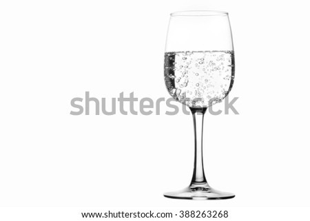 A glass of sparkling water isolated on white background - stock photo