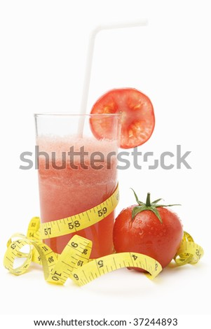 A glass of tomato juice with straw and measuring tape