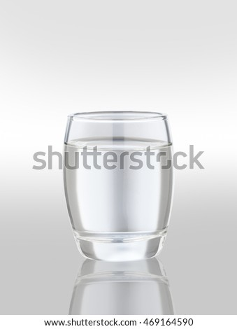 A glass of vodka on a light background.