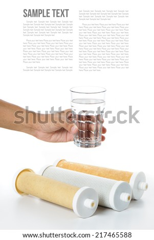a glass of water in hand with water filter - stock photo