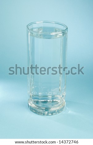a glass of water on a blue background