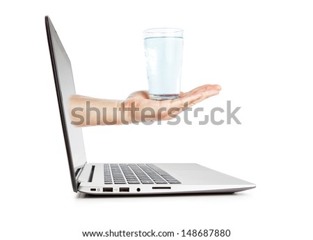 A glass of water on a break at work. Concept Image. - stock photo