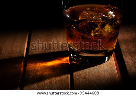 A glass of whiskey with ice - stock photo