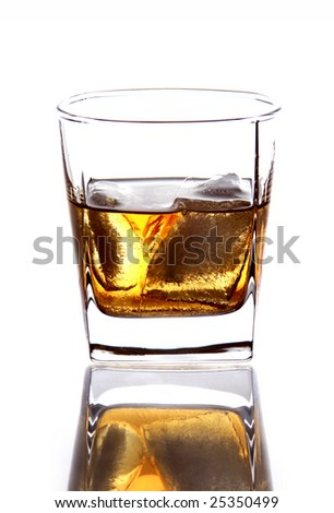 A glass of whiskey with ice isolated on white.