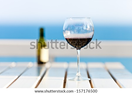 A Glass of Wine at the beach, standing on a footbridge in the south pacific - stock photo