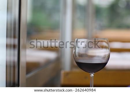 a glass of wine tasting restaurant - stock photo