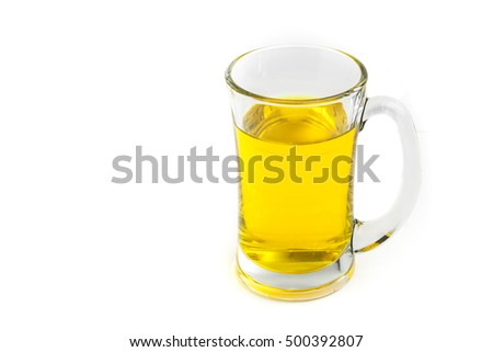 A glass of yellow color water on white background isolated with copy space