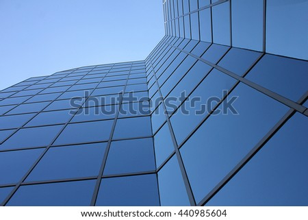 a glass skyscraper seen from below