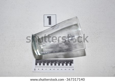 a glass with fingerprints. evidence. - stock photo