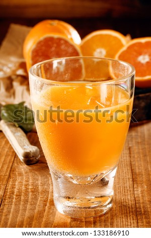 A glass with healthy fresh orange and grapefruit juice - stock photo