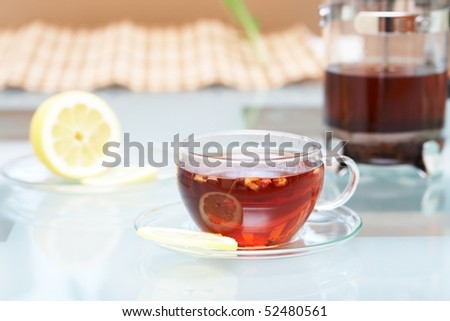 A glass with hot tea - stock photo