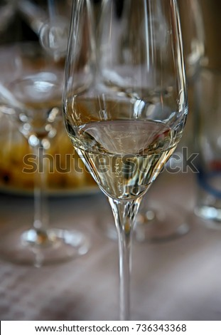 A glass with sparkling white wine