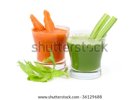 A glasses of fresh celery and carrot juice isolated on white background.
