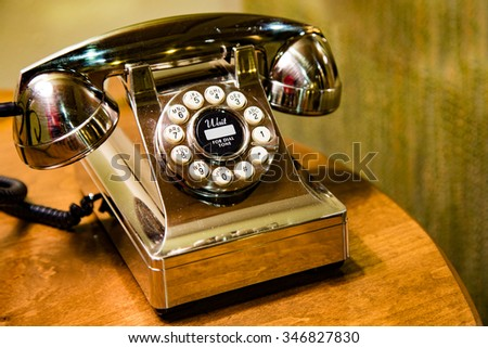 A gleaming gold telephone waiting for you to contact us, or just placed there for customer service