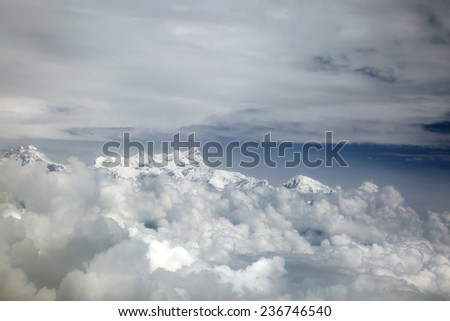 A glimpse of the Himalayan range through the clouds - stock photo