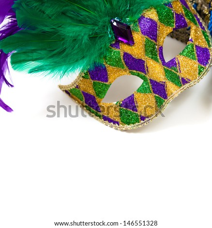 A glittery Mardi gras mask on a white background with copyspace - stock photo