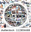 A globe is isolated on a white background with many different business people - stock photo