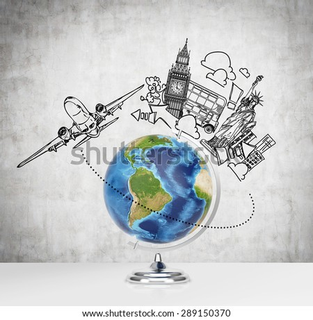 A globe on the table and the sketch of London and New York on the background. Elements of this image furnished by NASA - stock photo