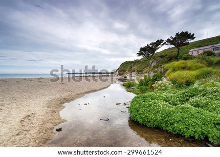 A gloomy day at Pendower Beach on the Roseland Peninsula in Cornwall - stock photo
