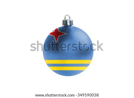 A glossy christmas ball in the national colors of aruba isolated on a white background.  - stock photo