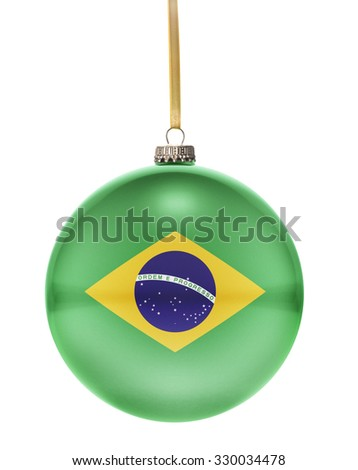A glossy christmas ball in the national colors of Brazil hanging on a golden string isolated on a white background.(series) - stock photo