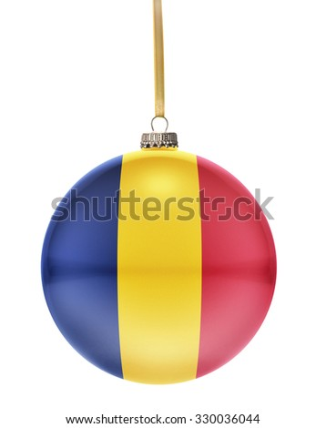 A glossy christmas ball in the national colors of Chad hanging on a golden string isolated on a white background.(series) - stock photo