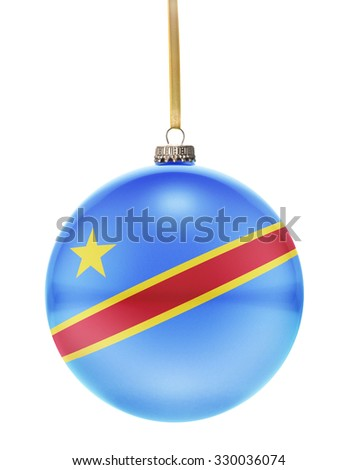 A glossy christmas ball in the national colors of Democratic Republic of the Congo hanging on a golden string isolated on a white background.(series) - stock photo