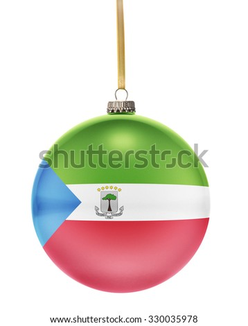 A glossy christmas ball in the national colors of Equatorial Guinea hanging on a golden string isolated on a white background.(series) - stock photo