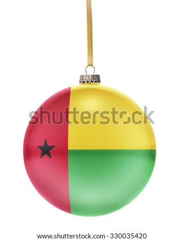 A glossy christmas ball in the national colors of Guinea-Bissau hanging on a golden string isolated on a white background.(series) - stock photo