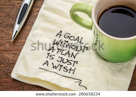 a goal without a plan is just a wish - motivational handwriting on a napkin with a cup of coffee - stock photo