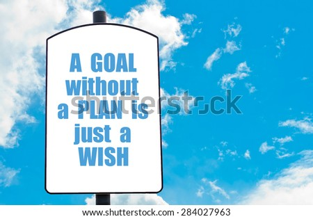 A Goal Without A Plan is Just a Wish motivational quote written on white road sign isolated over clear blue sky background. Concept  image with available copy space