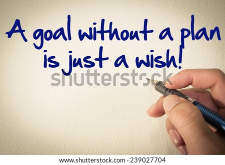 A goal without a plan is just a wish! text write on wall  - stock photo