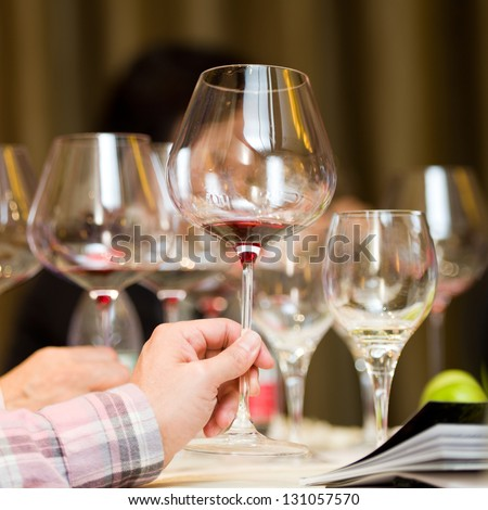 A goblet of wine in hand. - stock photo