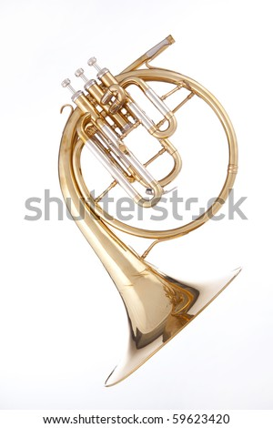 A gold brass antique French horn or peckhorn isolated against a white background.