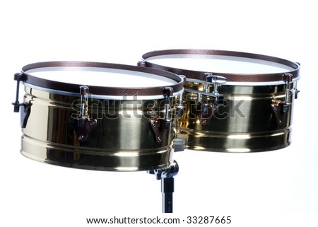 A gold brass timbales isolated against a white background in the horizontal format with copy space. - stock photo