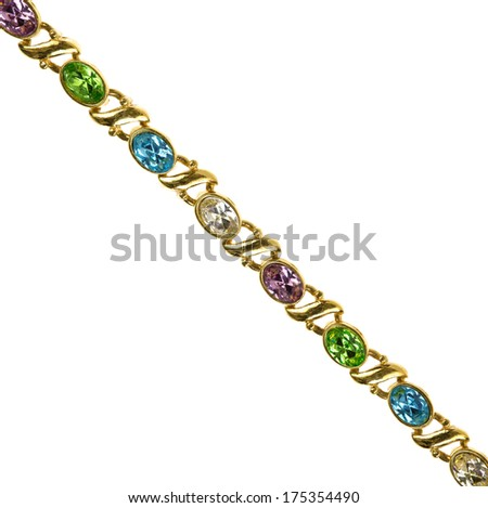 A gold costume jewelry bracelet with fake gemstones on a white background.