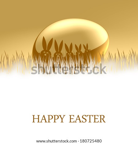 A gold Easter Egg with a bunnys on top lying in grass