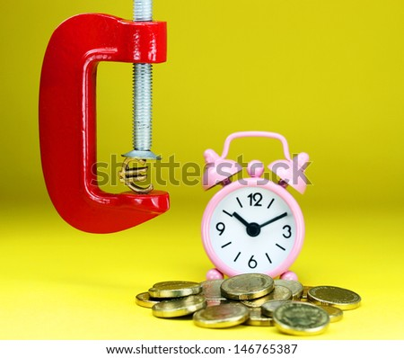 A Gold Euro Symbol in a red vice, with a pink clock resting on some gold coins in the background, asking the question how far will the Euro be squeezed.