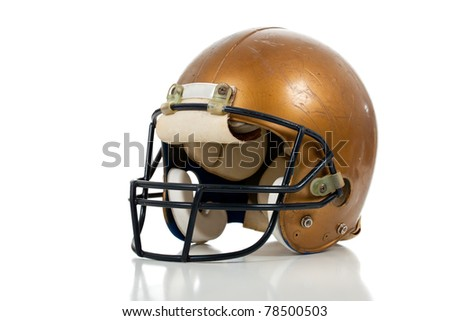 A gold football helmet on a white background - stock photo