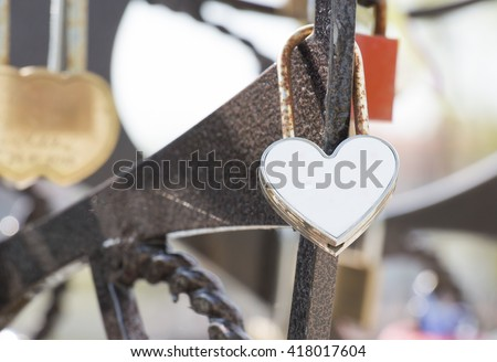 A gold heart is a lock, weighs - stock photo