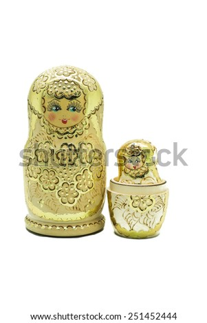 A gold matryoshka doll (Russian Doll) isolated on white - stock photo