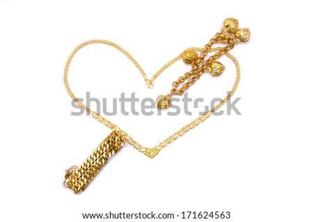 A Gold Necklace Form A Heart Love Shape With Arrow Sign Bracelet Inside Over White Background