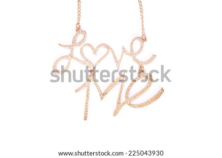 a gold necklace with the words love me on it. - stock photo
